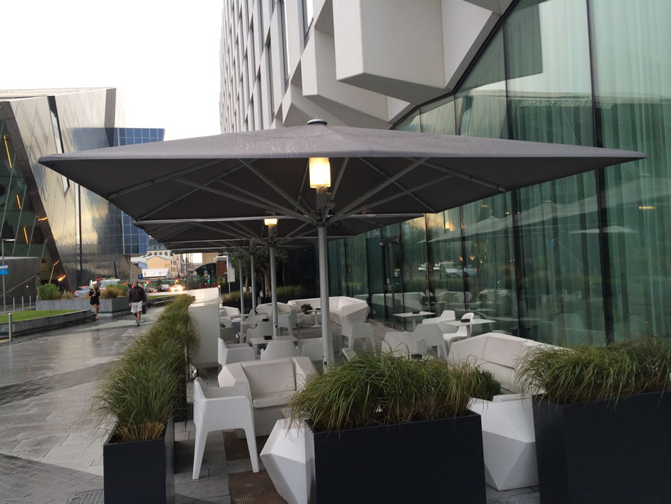 With a large range of sizes to adapt to open spaces complete with integrated heaters and lights this retractable solution ticks a lot of boxes. & Umbrellas - Downer International